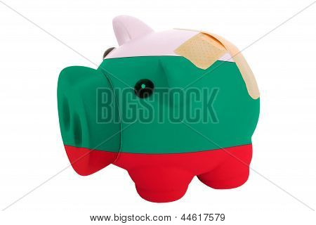 Closed Piggy Rich Bank With Bandage In Colors National Flag Of Bulgaria
