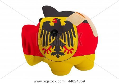 Closed Piggy Rich Bank With Bandage In Colors National Flag Of Germany