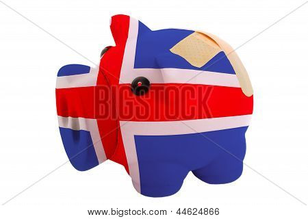 Closed Piggy Rich Bank With Bandage In Colors National Flag Of Iceland