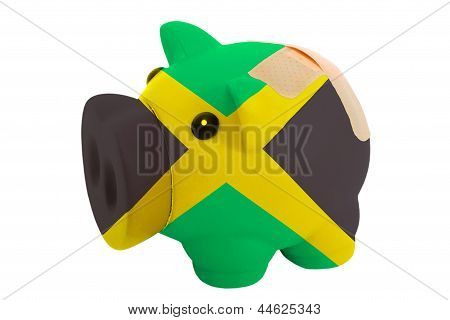 Closed Piggy Rich Bank With Bandage In Colors National Flag Of Jamaica