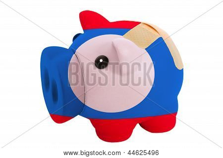 Closed Piggy Rich Bank With Bandage In Colors National Flag Of Laos