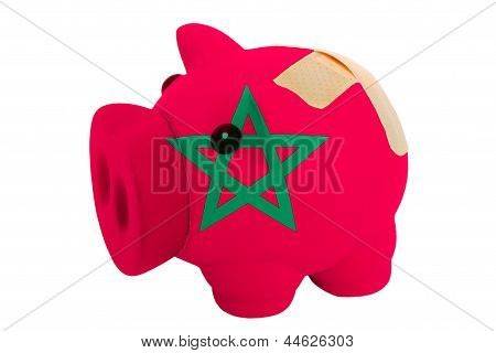 Closed Piggy Rich Bank With Bandage In Colors National Flag Of Morocco