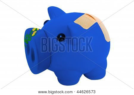 Closed Piggy Rich Bank With Bandage In Colors Flag Of American State Of Nevada