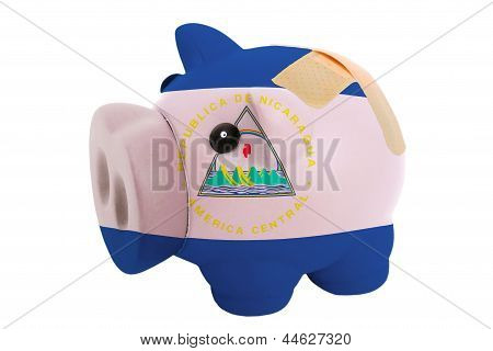 Closed Piggy Rich Bank With Bandage In Colors National Flag Of Nicaragua