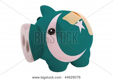 Closed Piggy Rich Bank With Bandage In Colors National Flag Of Pakistan