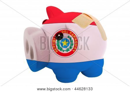 Closed Piggy Rich Bank With Bandage In Colors National Flag Of Paraguay
