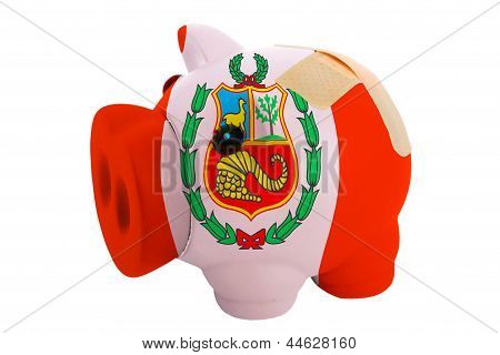 Closed Piggy Rich Bank With Bandage In Colors National Flag Of Peru