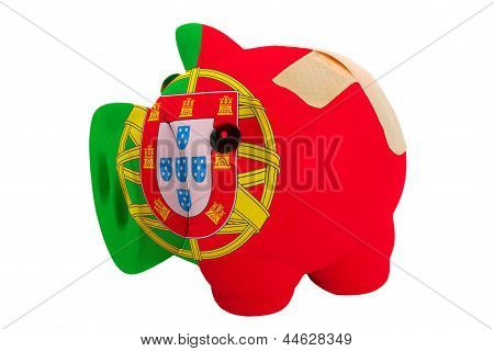 Closed Piggy Rich Bank With Bandage In Colors National Flag Of Portugal