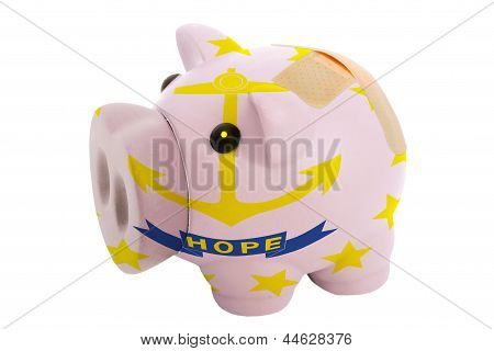 Closed Piggy Rich Bank With Bandage In Colors Flag Of American State Of Rhode Island