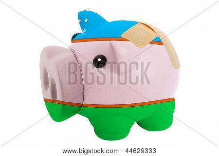 Closed Piggy Rich Bank With Bandage In Colors National Flag Of Uzbekistan