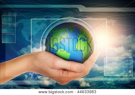Hand Holding Globe In Blue Virtual Interface