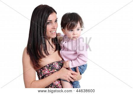 Attractive Mother Holding Her Daughter Baby And Watching At Side