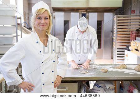 Baker Posing In Bakery Or Bakehouse