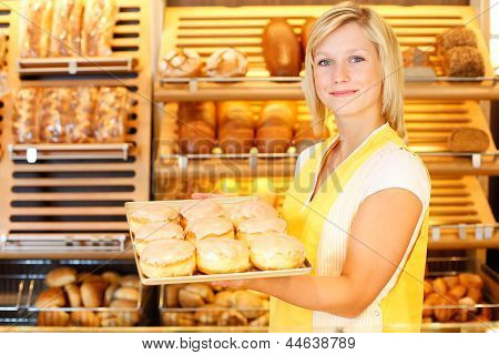 Bakery Shopkeeper Presents Doughnuts