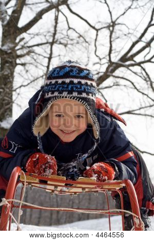 Kid On A Sledge
