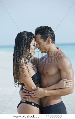 Couple romancing on the beach