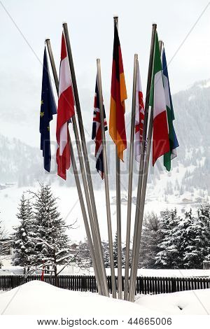 Flags Of Different Nations In The Snow