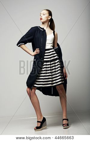 Ambitions. Confident Honorable Brunette In Black Waterproof Mackintosh. Vogue Style