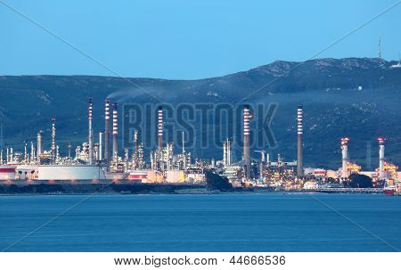 Oil Refinery Illuminated At Dusk