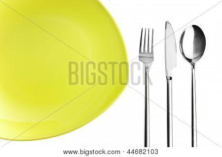 Зеленые пластины, вилка, нож и ложкой