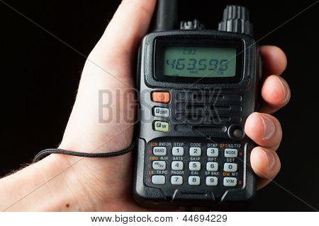 professional walkie-talkie radio in hand poster