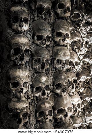 Wall full of skulls and bones in the bone chapel in Evora, Portugalhe bone chapel in Evora, Portugal