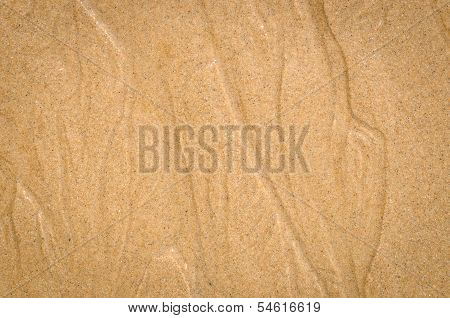 Watercourse On Wet Sand Pattern Of A Beach