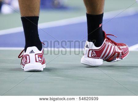 Six times Grand Slam champion Novak Djokovic wears custom Adidas tennis shoes at US Open 2013