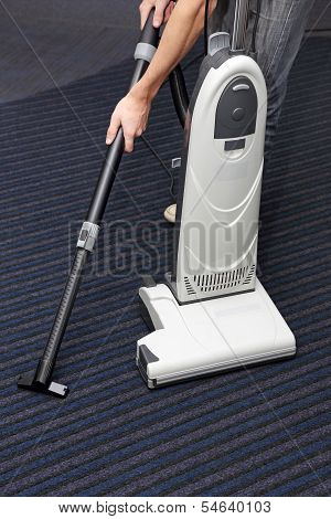 Man Is Cleaning The Carpet
