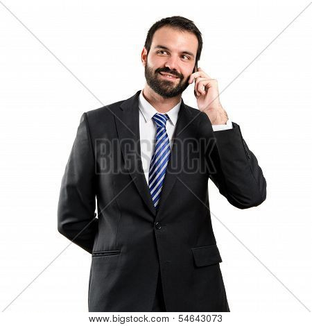 Young Businessmen Talking To Mobile Over Isolated Background.