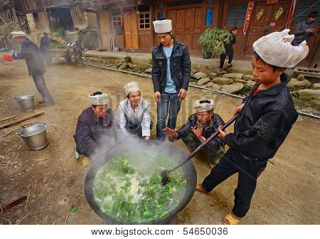 Men Asians, Chinese Peasants, Farmers, Cook On  Rural Street Village.