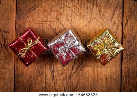 Gift Boxes On Wood Background