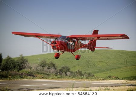 Red Plane Manned By Student and flight instructor of a class flight Practice, Jaen, Andalusia, Spain