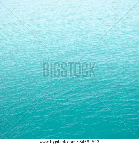 clear green sea with waves for background poster