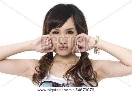 Young woman of Asian with cool expression on face, half length closeup portrait