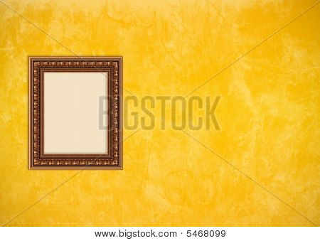 Grunge Yellow Or Gold Stucco Wall With Empty Picture Frame