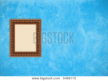 Empty baroque picture frame with copyspace on a blue grunge stucco wall poster