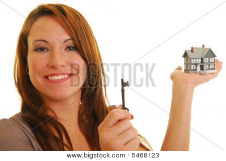 Attractive Woman With Skeleton Key And Miniature House