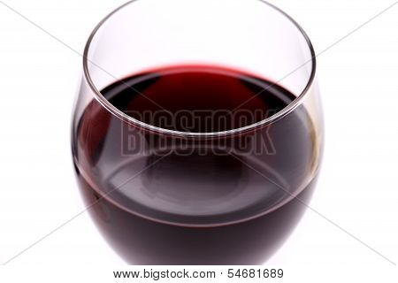 Glass of red wine. Close-up.