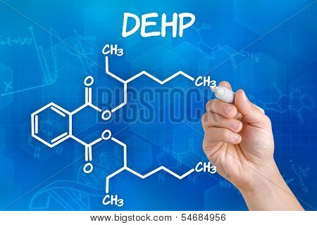 Hand with pen drawing the chemical formula of DEHP