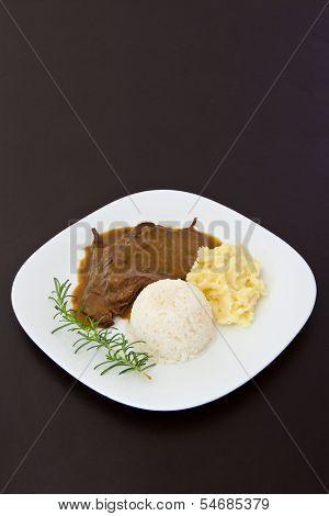 Roast eye of round with roti sauce dish - vertical image