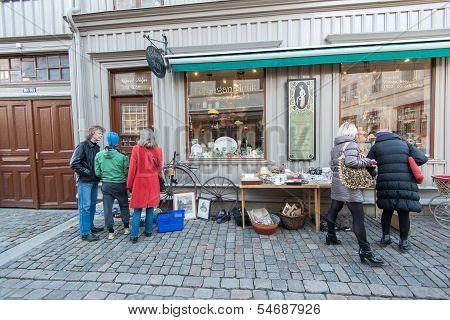 Window shoppers in historic Haga of Gothenburg, Sweden