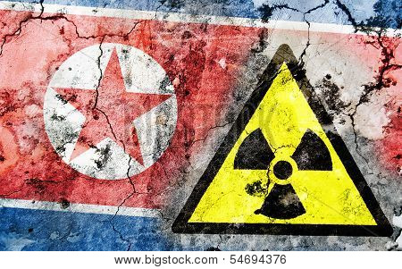 Old Cracked Wall With Radiation Warning Sign And Painted Flag