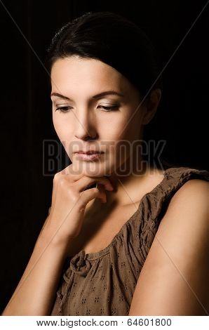 Melancholy Woman With A Serious Expression