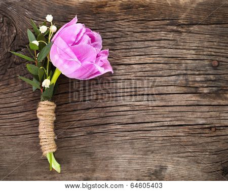 Purple Tulip Buttonhole For Groom On The Wooden Background