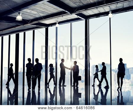 Group of business people standing in a office building.