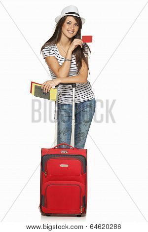 Female in casual standing with travel suitcase