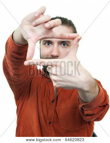 the young man gesturing hand frame against
