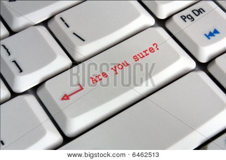computer keyboard enter key saying are you sure in red writing