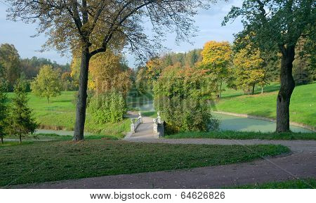 Iron bridge (1823 architect Carlo Rossi) across Slavyanka river in autumn. Pavlovsk park Saint Petersburg Russia poster